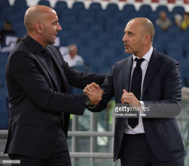 Sportif Director of FC Internazionale Milano Piero Ausilio greets Sportif Director of AS Roma Monchi prior to the Serie A match between AS Roma and...