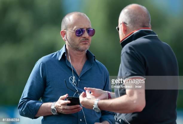 Sportif Director of FC Internazionale Milano Piero Ausilio speaks to Chief Football Administrator of FC Internazionale Milano Giovanni Gardini during...
