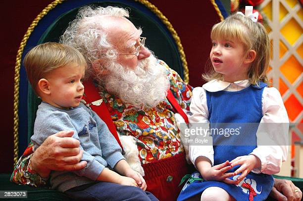 Sporting a natural white beard Santa Claus visits with Ian and sister Devin Rachiele December 19 2003 at Golf Mill Mall in Niles Illinois Santa says...