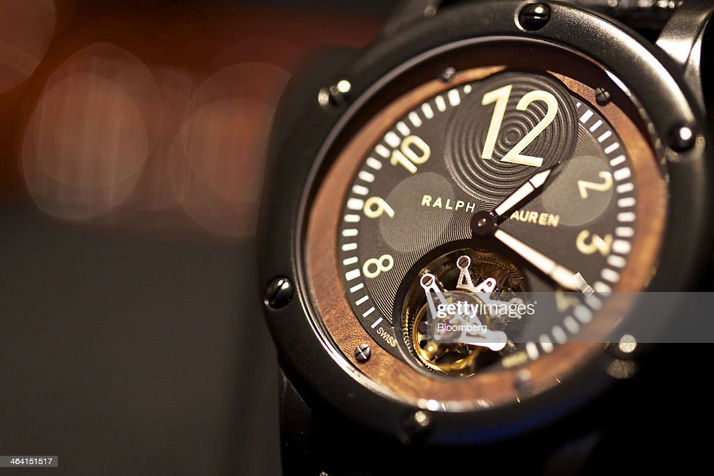 A Sporting Black Safari Flying Tourbilon luxury wristwatch, manufactured by Ralph Lauren, a part-owned unit of Cie. Financiere Richemont SA, sits on display at the Salon International de la Haute Horlogerie (SIHH) watch fair in Geneva, Switzerland, on Monday, Jan. 20, 2014. Enthusiasts coveting $50,000 Cartier watches at the Swiss industry's annual fair bumped opening meetings to resolve the three-year-old Syrian civil war out of the lakeside town. Photographer: Gianluca Colla/Bloomberg via Getty Images