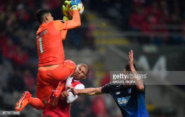 Sporting Braga's Brazilian goalkeeper Matheus crashes with teammate Brazilian midfielder Raul Silva beside Hoffenheim's Hungarian forward Adam Szalai...