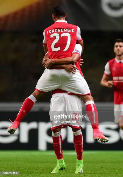 Sporting Braga's Brazilian midfielder Fransergio celebrates with a teammate after scoring during the UEFA Europa league football match SC Braga vs...