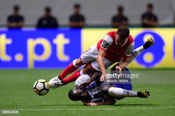 Sporting Braga's defender Nuno Sequeira falls with Porto's Malian forward Moussa Marega during the Portuguese league football match Sporting Clube de...