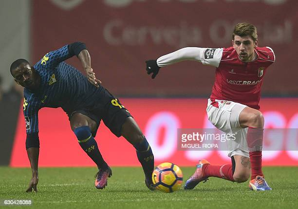 Sporting Braga's defender Xeka vies with Moreirense's French forward Ousmane Drame during the Portuguese league football match SC Braga vs Moreirense...
