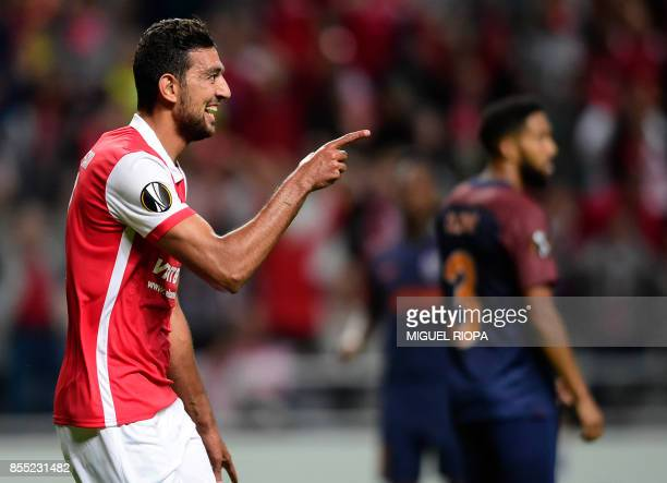 Sporting Braga's Egytian forward Ahmed Hassan celebrates after scoring the opening goal during the UEFA Europa league football match SC Braga vs...