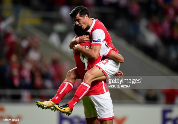 Sporting Braga's Egytian forward Ahmed Hassan celebrates with teammate midfielder Joao Carlos after scoring the opening goal during the UEFA Europa...