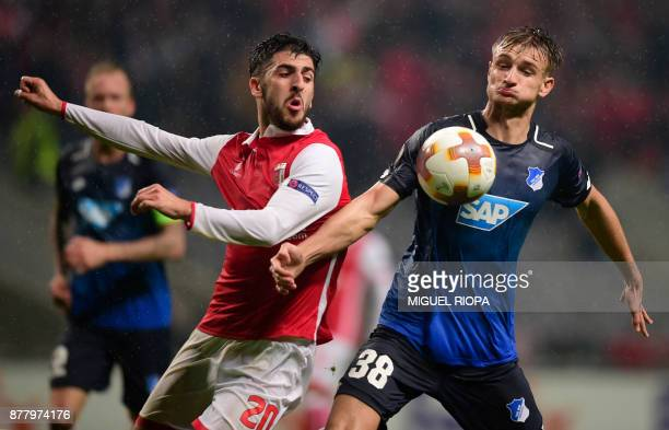 Sporting Braga's forward Paulinho vies with Hoffenheim's Austrian defender Stefan Posch during the Europa League football match SC Braga vs TSG 1899...