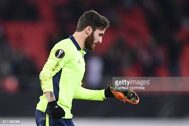 Sporting Braga's Portugese forward Rafa Silva holds his shoe after scoring during the UEFA Europa League round of 32 first leg football match between...