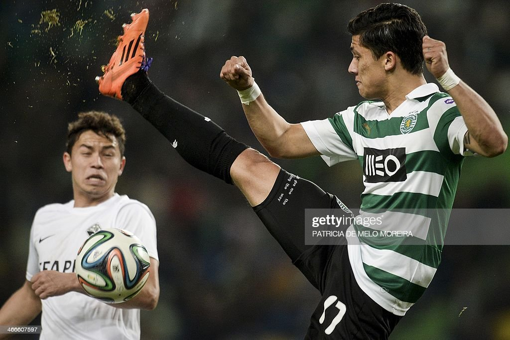 Sporting Colombian forward Fredy Montero (R) kicks the ball during the Portuguese league football match Sporting vs Academica at the Alvalade stadium on February 2, 2014. The game ended in a draw 0-0.