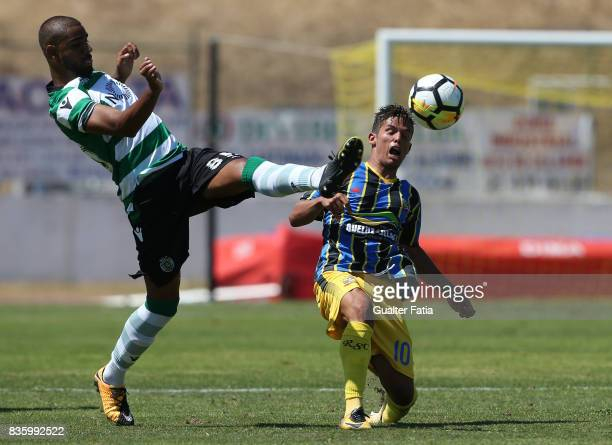 Sporting CP B defender David Sualehe with Real SC midfielder Kikas from Portugal in action during the Segunda Liga match between Real SC and Sporting...