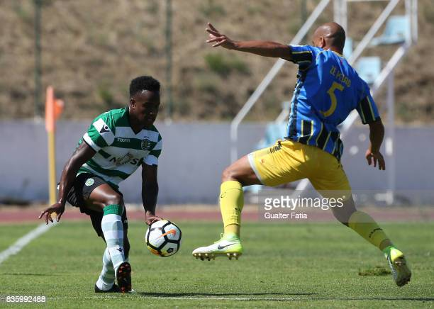 Sporting CP B forward Jovane Cabral with Real SC defender Jose Pedro from Portugal in action during the Segunda Liga match between Real SC and...