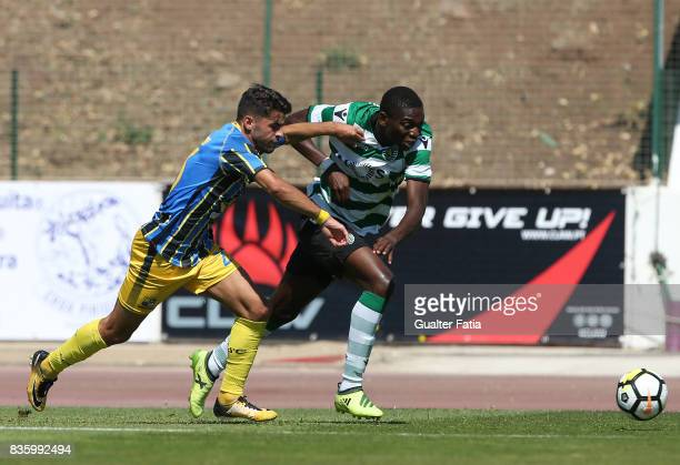 Sporting CP B forward Rafael Leao with Real SC defender Jorge Bernardo from Portugal in action during the Segunda Liga match between Real SC and...