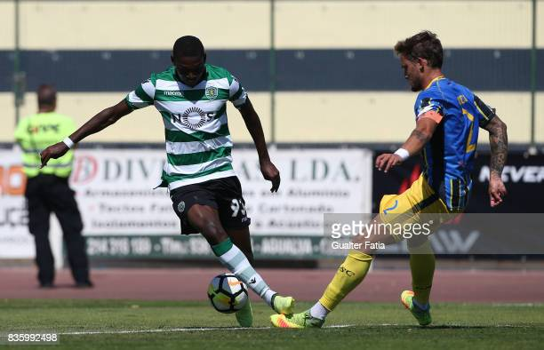 Sporting CP B forward Rafael Leao with Real SC defender Vasco Coelho from Portugal in action during the Segunda Liga match between Real SC and...