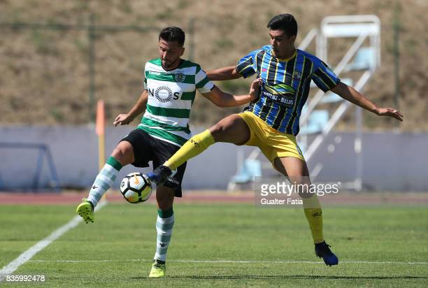 Sporting CP B midfielder Cristian Ponde with Real SC defender Joao Basso from Brazil in action during the Segunda Liga match between Real SC and...