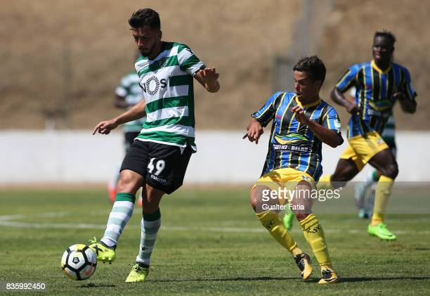 Sporting CP B midfielder Cristian Ponde with Real SC midfielder Kikas from Portugal in action during the Segunda Liga match between Real SC and...