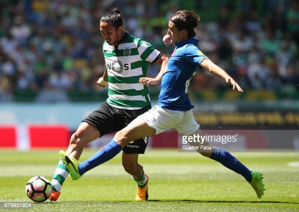 Sporting CP defender Ezequiel Schelotto from Argentina with Belenenses's forward Juanto Ortuno from Spain in action during the Primeira Liga match...