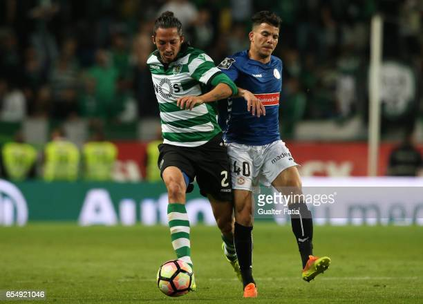Sporting CP defender Ezequiel Schelotto from Argentina with Nacional midfielder Zizo from Egypt in action during the Primeira Liga match between...