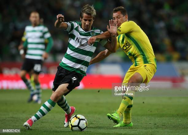 Sporting CP defender Fabio Coentrao from Portugal with CD Tondela forward Mateusz Zachara from Poland in action during the Primeira Liga match...