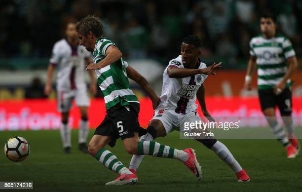 Sporting CP defender Fabio Coentrao from Portugal with GD Chaves forward Hamdou Elhouni from Lebanon in action during the Primeira Liga match between...