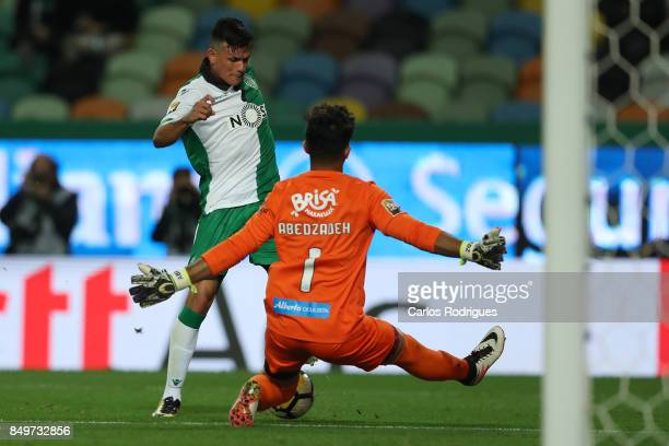 Sporting CP defender Jonathan Silva from Argentina tries to beat CS Maritimo goalkeeper Amir Abedzadeh from Iran during the match between Sporting CF...