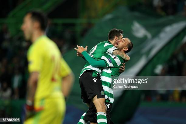 Sporting CP forward Bas Dost from Holland celebrates after scoring Sporting third goal with Sporting CP midfielder Bruno Fernandes from Portugal...