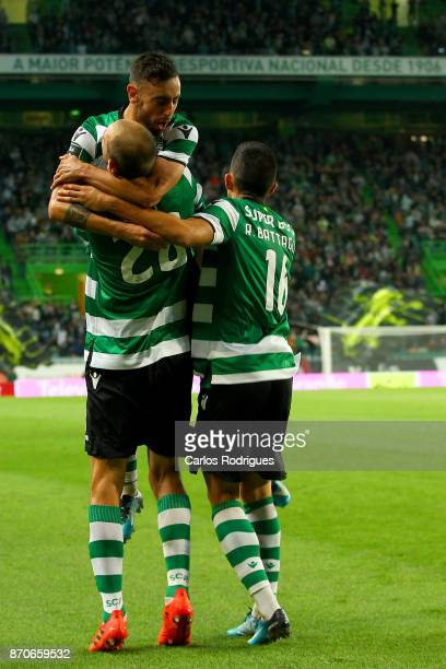 Sporting CP forward Bas Dost from Holland celebrates scoring Sporting first goal with Sporting CP midfielder Bruno Fernandes from Portugal and...