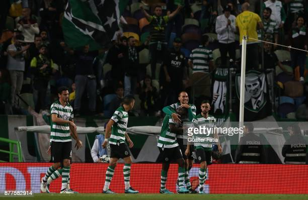Sporting CP forward Bas Dost from Holland celebrates with teammates after scoring a goal during the UEFA Champions League match between Sporting...