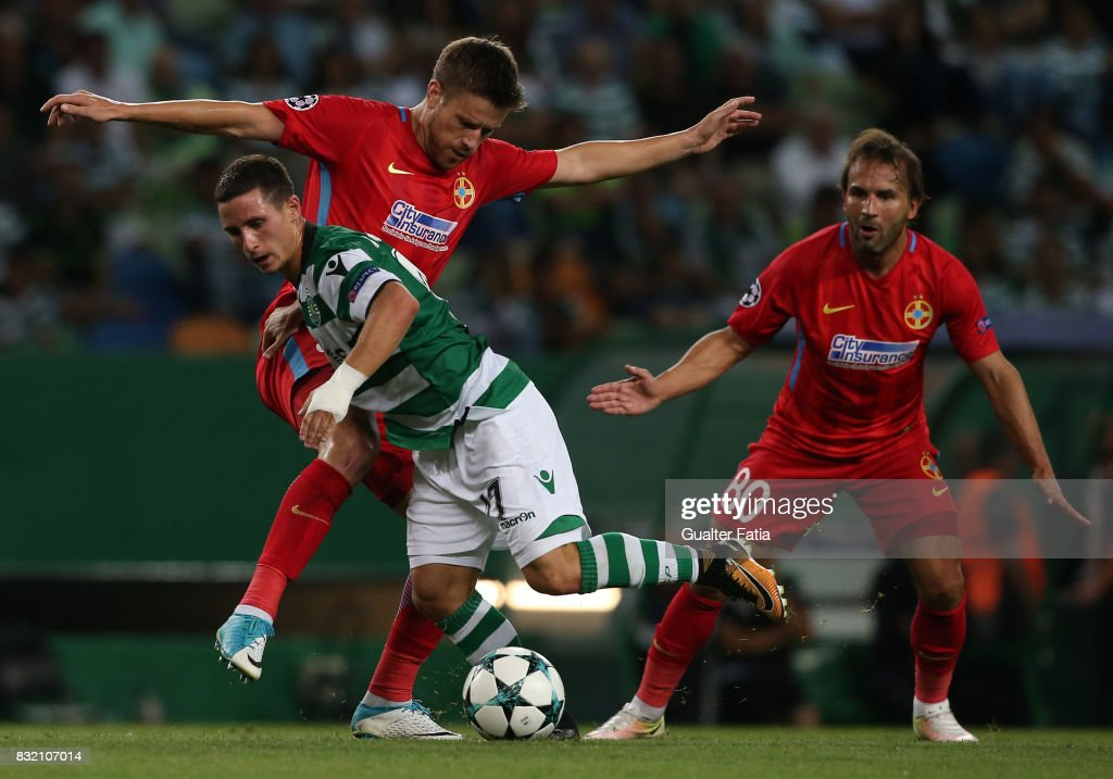 Sporting CP forward Daniel Pondence from Portugal with Steaua Bucuresti FC midfielder Mihai Pintilii from Romania and Steaua Bucuresti FC midfielder Filipe Teixeira from Portugal in action during the UEFA Champions League Qualifying Play-Offs Round - First Leg match between Sporting Clube de Portugal and Steaua Bucuresti FC at Estadio Jose Alvalade on August 15, 2017 in Lisbon, Portugal.