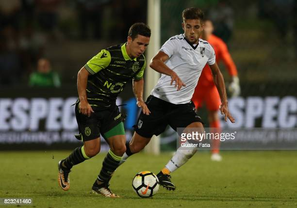 Sporting CP forward Daniel Pondence from Portugal with Vitoria Guimaraes forward Joao Vigario from Portugal in action during PreSeason Friendly match...
