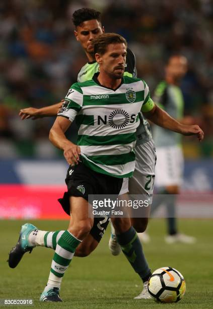 Sporting CP midfielder Adrien Silva from Portugal with Vitoria Setubal midfielder Andre Pedrosa from Portugal in action during the Primeira Liga...