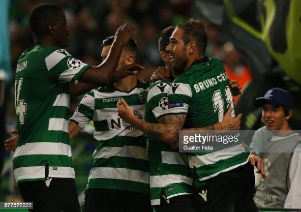 Sporting CP midfielder Bruno Cesar celebrates with teammates after scoring a goal during the UEFA Champions League match between Sporting Clube de...