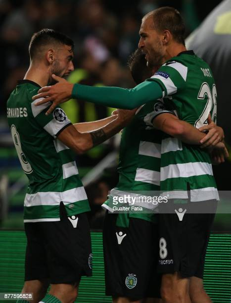Sporting CP midfielder Bruno Cesar from Brazil celebrates with teammates after scoring a goal during the UEFA Champions League match between Sporting...