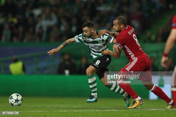 Sporting CP midfielder Bruno Fernandes from Portugal vies with Olympiakos Piraeus midfielder Vadis Odjidja from Belgium for the ball possession...
