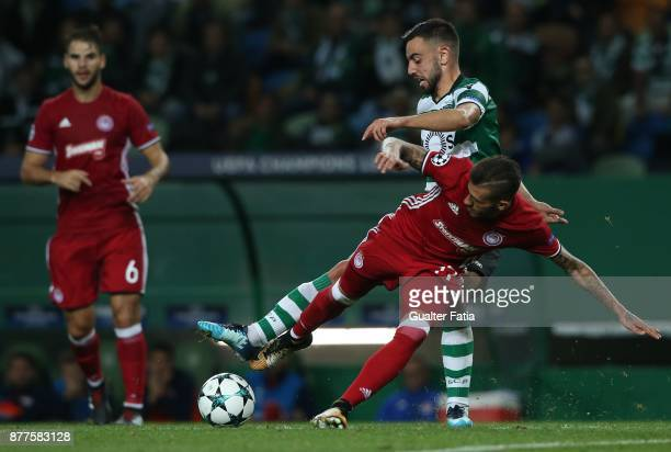 Sporting CP midfielder Bruno Fernandes from Portugal with Olympiakos Piraeus defender Diogo Figueiras from Portugal in action during the UEFA...