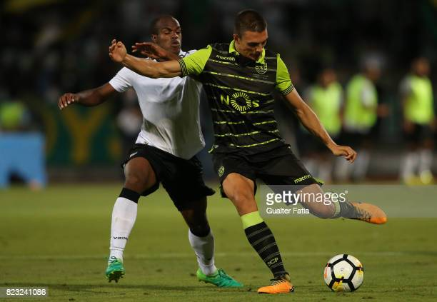 Sporting CP midfielder Joao Palhinha from Portugal with Vitoria Guimaraes forward Estupinan from Colombia in action during PreSeason Friendly match...
