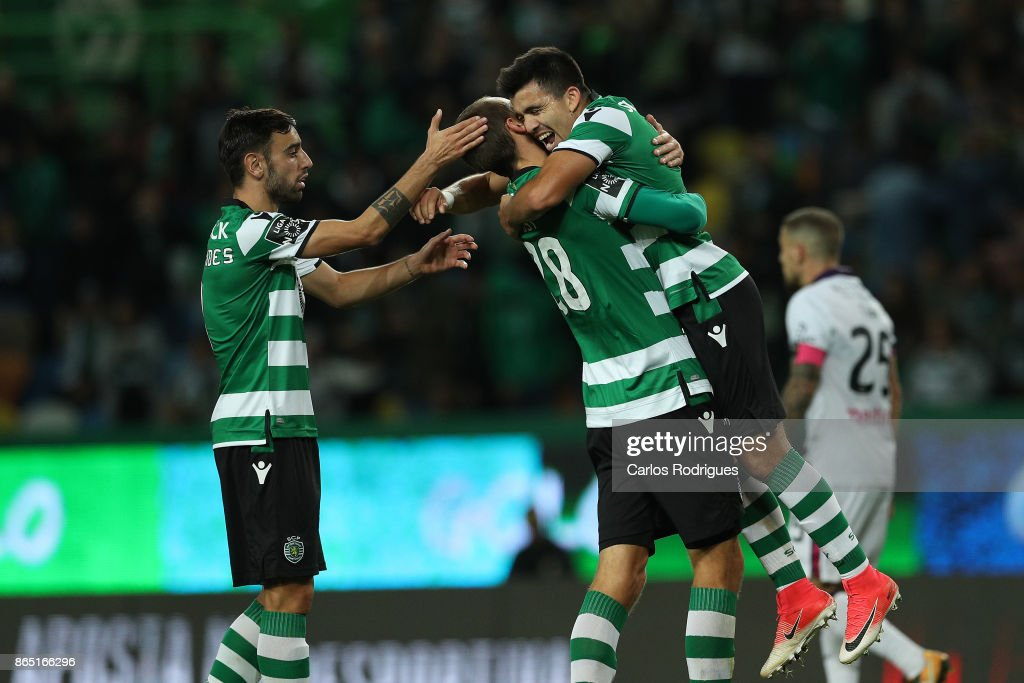 Sporting CP midfielder Marcos Acuna from Argentina (R) celebrates scoring Sporting fourth goal with Sporting CP forward Bas Dost from Holland (L) during the Portuguese Primeira Liga round nine match between Sporting CP and GD Chaves at Estadio Jose Alvalade on October 22, 2017 in Lisbon, Portugal.