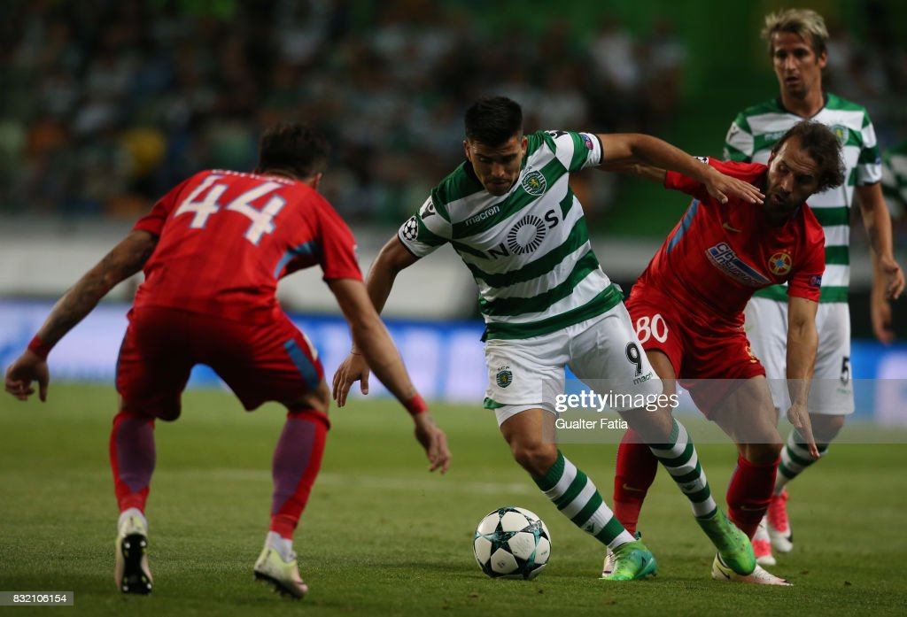 Sporting CP midfielder Marcos Acuna from Argentina with Steaua Bucuresti FC midfielder Gabriel Enache from Romania and Steaua Bucuresti FC midfielder Filipe Teixeira from Portugal in action during the UEFA Champions League Qualifying Play-Offs Round - First Leg match between Sporting Clube de Portugal and Steaua Bucuresti FC at Estadio Jose Alvalade on August 15, 2017 in Lisbon, Portugal.