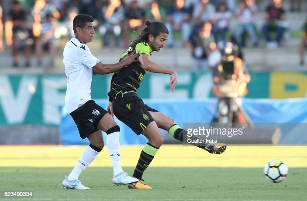 Sporting CP midfielder Matheus Oliveira from Brazil with Vitoria Guimaraes forward Paolo Hurtado from Peru in action during PreSeason Friendly match...