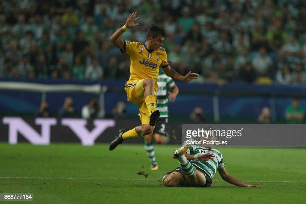Sporting CP midfielder Rodrigo Battaglia from Argentina vies with Juventus forward Paulo Dybala from Argentina during the UEFA Champions League group...