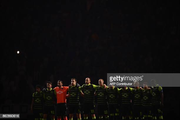 Sporting CP players pay tribute to the victims of fires in Portugal before the UEFA Champions League Group D football match Juventus vs Sporting CP...