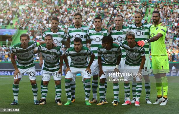 Sporting CP players pose for a team photo before the start of the UEFA Champions League Qualifying PlayOffs Round First Leg match between Sporting...