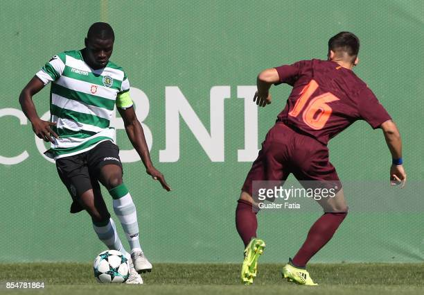 Sporting CP's Abdu Conte with FC Barcelona Carles Perez in action during the UEFA Youth League match between Sporting CP and FC Barcelona at CGD...