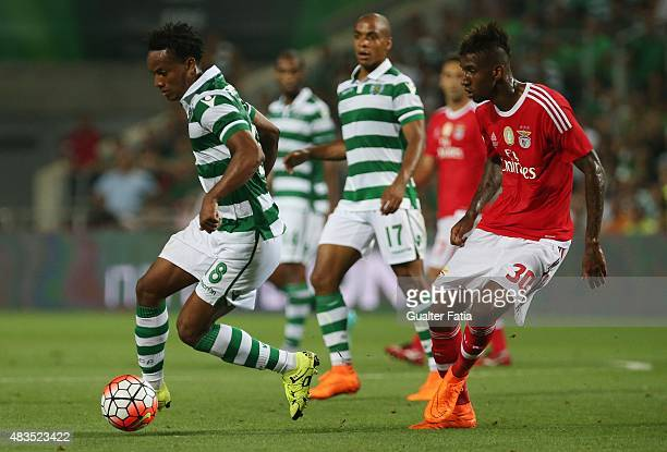 Sporting CP's Carrillo with SL Benfica's midfielder Talisca in action during the Portuguese Super Cup match between SL Benfica and Sporting CP at...