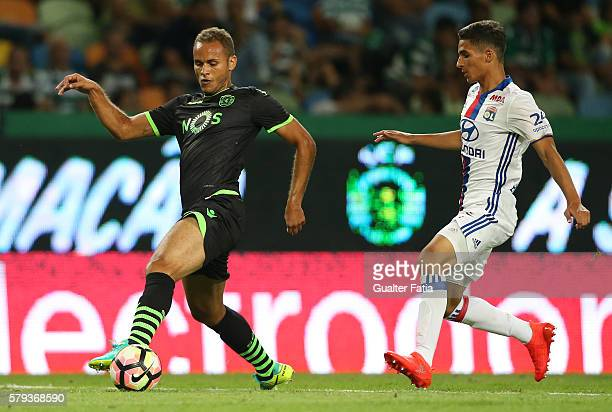 Sporting CP's defender Ewerton from Brazil with Lyon's forward Houssem Aouar in action during the Pre Season Friendly match between Sporting CP and...
