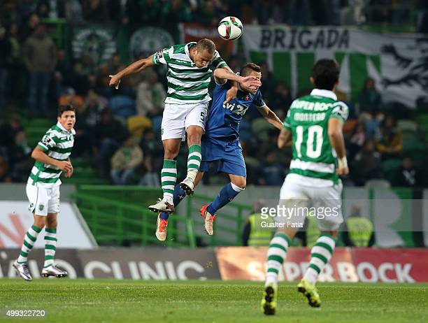 Sporting CP's defender Ewerton with Os Belenenses' midfielder Andre Sousa in action during the Primeira Liga match between Sporting CP and Os...