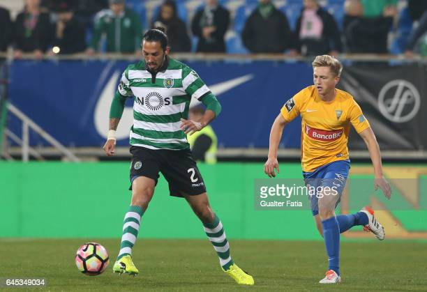 Sporting CP's defender Ezequiel Schelotto from Argentina with Estoril's midfielder Dmytro Yarchuk from Ucrania in action during the Primeira Liga...