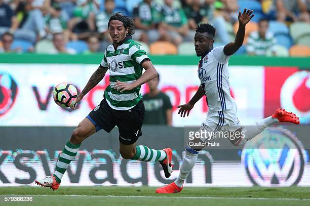 Sporting CP's defender Ezequiel Schelotto from Argentina with Lyon's forward Maxwel Cornet in action during the Pre Season Friendly match between...