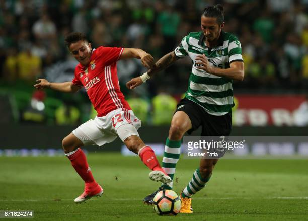 Sporting CP's defender Ezequiel Schelotto from Argentina with SL Benfica's forward from Argentina Franco Cervi in action during the Primeira Liga...