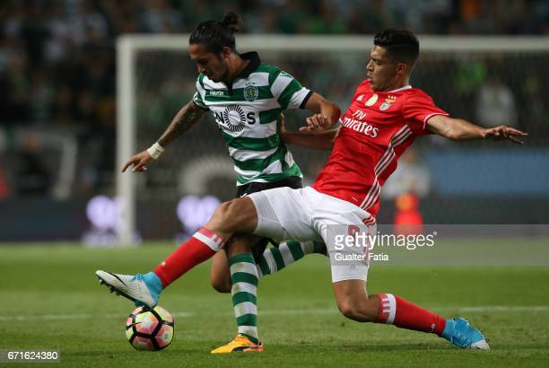 Sporting CP's defender Ezequiel Schelotto from Argentina with SL Benfica's forward from Mexico Raul Jimenez in action during the Primeira Liga match...
