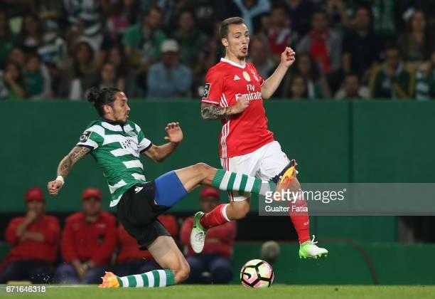 Sporting CPÕs defender Ezequiel Schelotto from Argentina with SL BenficaÕs defender from Spain Alex Grimaldo in action during the Primeira Liga match...